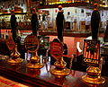 HANDPUMPED BEERS AT THE BISHOPS ARMS PUB OPP MALMO CENTRAL STATION SWEDEN SEP 2013 (10043609334).jpg