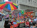 HK 灣仔街市 Wan Chai Market 太原街 Tai Yuen Street stall beach umbrella n visitors Apr-2014.JPG