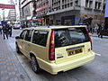 HK Central Queen's Road Volvo motor car in milk yellow color.JPG