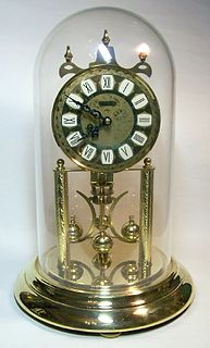Torsion pendulum clock Clock that uses a torsion pendulum to keep time