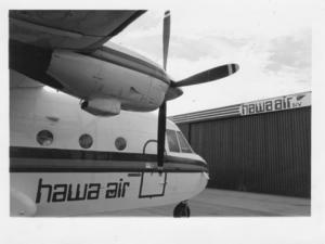 Hawa Air - The Hawa Air C-212-200 Aviocar before the purposely built hangar of the same company.