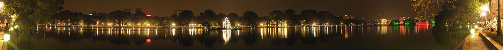 A panoramic view of the Hoan Kiem Lake by night.