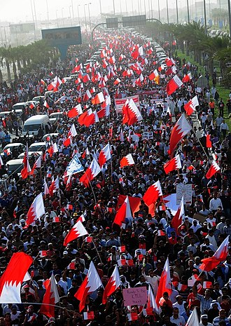 """Timeline of the Bahraini uprising of 2011 - Hundreds of thousands of Bahrainis taking part in the """"March of Loyalty to Martyrs"""", honoring political dissidents killed by security forces, on 22 February."""