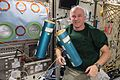 ISS-48 Jeff Williams with BRIC Canisters in the Destiny lab.jpg