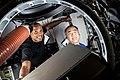 ISS-64 Glover and Noguchi load cargo.jpg