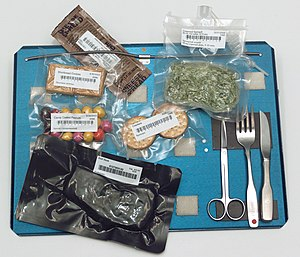 Space food - Food aboard the Space Shuttle served on a tray. Note the use of magnets, springs, and Velcro to hold the cutlery and food packets to the tray