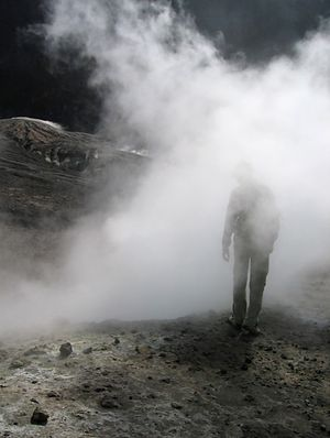 Man walking into the mist, within the crater o...