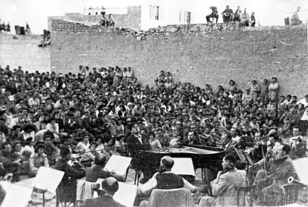 The Israel Philharmonic Orchestra performs in the desert town of Beersheba, 1948. IsraelPhil.jpg