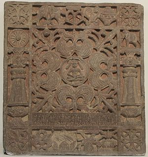 Buddhism and Jainism - Image: Jain Votive Plaque made in spotted red sandstone, Kushana artefacts, National Museum, New Delhi 03