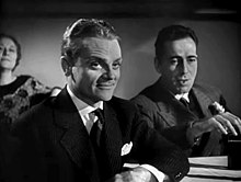 Bogart behind a smiling James Cagney in a film trailer