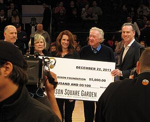 Jamie Dixon - Jamie Dixon, in Madison Square Garden, along with his sister Julie and their parents, accepting a check from the Garden donated to the Maggie Dixon Fund during the Maggie Dixon Classic.