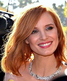 A photograph of Chastain smiling at the 2016 Cannes Film Festival