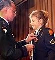 Jessica Lynch gets a medal.jpg