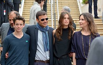Young & Beautiful - François Ozon (second from left) with Fantin Ravat, Marine Vacth, and Géraldine Pailhas at the 2013 Cannes Film Festival. Frédéric Pierrot can be seen behind Ravat.