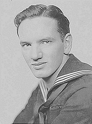 Joe Gill - Joe Gill in sailor's uniform, 1940s on board the USS Cavalier APA 37