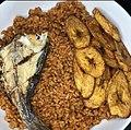 Jollof rice with fried fish and plantain.jpg