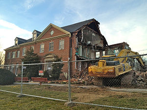Adaptive reuse - The Kelso Home for Girls in Baltimore, Maryland was a typical candidate for adaptive reuse, but it was razed to accommodate parking for a new athletic facility when the cost of conversion was found to be too great