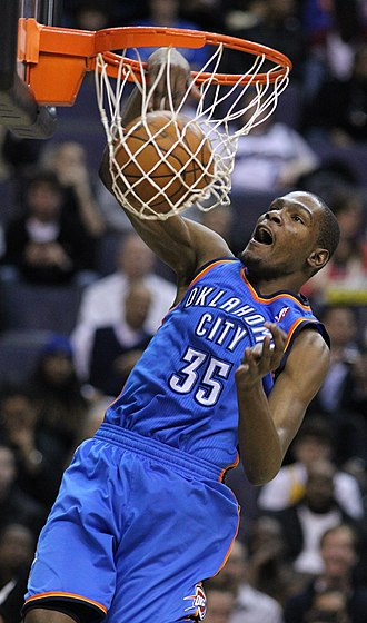 Kevin Durant - Durant scores on a slam dunk in March 2011 as a member of the Oklahoma City Thunder.