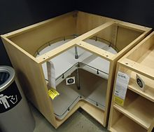 A Corner Cabinet With A Turntable For Easier Access.