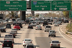 California English - Freeway signs along northbound US 101 at the interchange of Highway 110 in Los Angeles. The leftmost sign for US 101 north lists its name, the Hollywood Freeway, as well as its destination, Ventura.