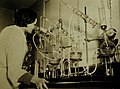 Laboratory chemist tests purity of gelatin used for such vitamin capsules, WWII (22573376628).jpg
