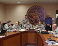 Larry Stice, standing right, the director of state resource management, gives a status update to U.S. Army Brig. Gen. Robbie Asher, the director of the Joint Staff, Oklahoma National Guard, during 130522-Z-VF620-3809.jpg