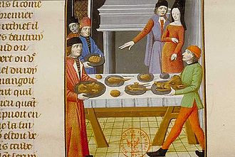 Entremets - A serving of boar's head, a popular form of entremets. The image of the boar caught with an apple in its mouth was possibly among the first dishes to attempt an imitation of a live animal.