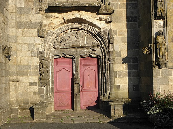 The double doored west porch with tympanum