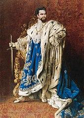 Ludwig II. von Bayern nach einem Gemälde von Gabriel Schachinger, posthum vollendet 1887. Das nach französischen Vorbildern gefertigte Bildnis zeigt den König im Gewand des Großmeisters des Ordens des heiligen Georg und hängt im Museum von Schloss Herrenchiemsee. (Quelle: Wikimedia)