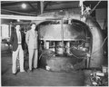 M. Stanley Livingston (L) and Ernest O. Lawrence in front of 27-inch cyclotron at the old Radiation Laboratory at the... - NARA - 558593.tif
