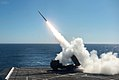 M142 HIMARS is fired from the flight deck of USS Anchorage (LPD-23) on 22 October 2017 (171022-N-GG858-008).JPG