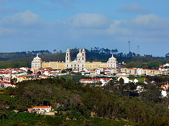 Mafra, Portugal - The Mafra National Palace overlooking the centre of Mafra