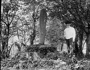 Man standing aside monument