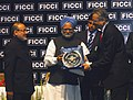 """Manmohan Singh presenting award for excellency to the Chairman of ITC Ltd Kolkata, Shri Yogesh Chander Deveshwar, in the field of """"Outstanding Vision Corporate-Triple Impact Business Performance.jpg"""