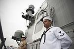 Manning the rails as USS America departs Rio De Janeiro 140809-N-FR671-043.jpg