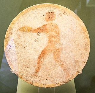 Marble disk depicting a diskobolos.jpg
