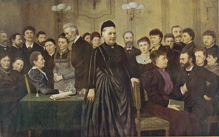 Line luplau seen in the foreground on her daughter Marie Luplau's large group portrait painting From the Early Days of the Fight for Women's Suffrage (1897). Marie Luplau - Fra Kvindevalgretskampens forste dage (1897),.jpg