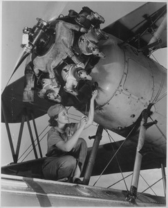 Mary Josephine Farley, who at 20 is considered a top notch mechanic, working on a Wright Whirlwind airplane motor... - NARA - 535576.tif