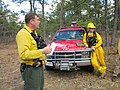 Mashpee, Massachusetts, April 5, 2012. Burn boss Joel Carlson (left) of Northeast Forest and Fire Managment does a safety briefing for a controlled burn at the Town of Mashpee Holland Hill Barrens (6914741288).jpg