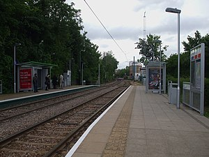 Merton Park tramstop look west.JPG