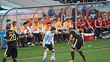 220px-Messi_Podolski_Boateng_bench_2010