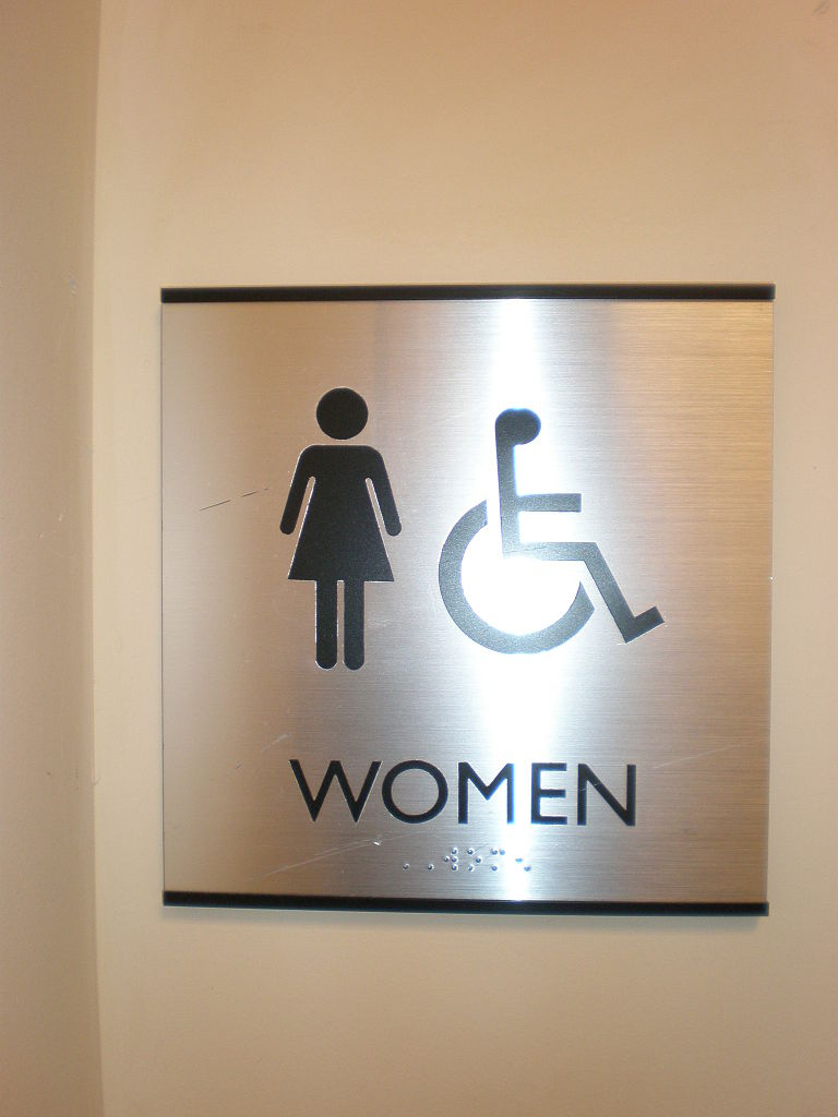 File:Metal female restroom sign with braille.JPG - Wikimedia Commons