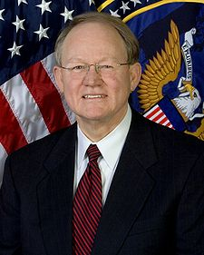 225px-Mike_McConnell%2C_official_ODNI_photo_portrait.jpg