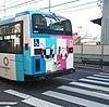 Olympia baskılı Tokyo'da otobüs