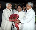 Mohd. Hamid Ansari being received by the Governor of Bihar, Dr. D. Y. Patil and the Chief Minister of Bihar, Shri Nitish Kumar, on his arrival at Jai Prakash Narayan International Airport, at Patna on September 25, 2013.jpg