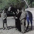 Monaca held by trainer Oscar Banegas standing by his father Mr. Natalio C. Banegas.jpg