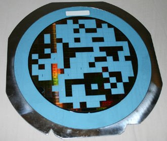 Die preparation - Wafer glued on blue tape and cut into pieces, with some individual die removed
