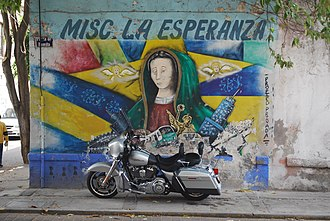 La Romita - Mural of the Virgin of Guadalupe with Harley Davidson motorcycle next to the main plaza