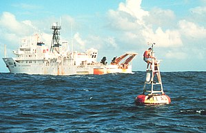 USNS Titan (T-AGOS-15) - NOAAS Ka'imimoana (R 333) services an Atlas buoy in the equatorial Pacific Ocean. Atlas buoys measure ocean temperature at varying depths and provide warning of upcoming El Niño and La Niña events.
