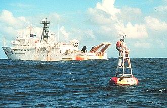 USNS Titan (T-AGOS-15) - NOAAS Ka'imimoana (R 333) services an Atlas buoy in the equatorial Pacific Ocean. Atlas buoys measure ocean temperature at varying depths and provide warning of upcoming El Niño and La Niña events.